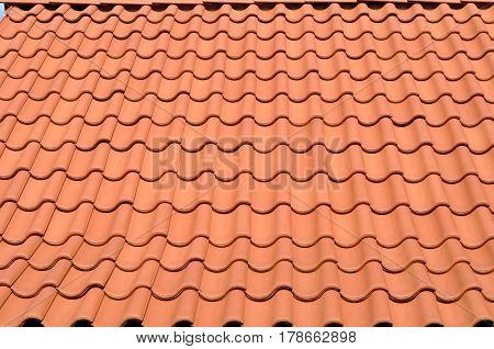 red tiled roof on the house as a background