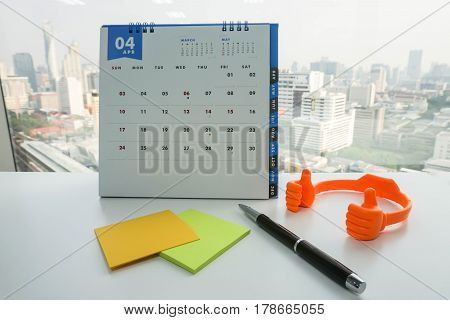 April calendar for meeting with mock up postit and pen for message