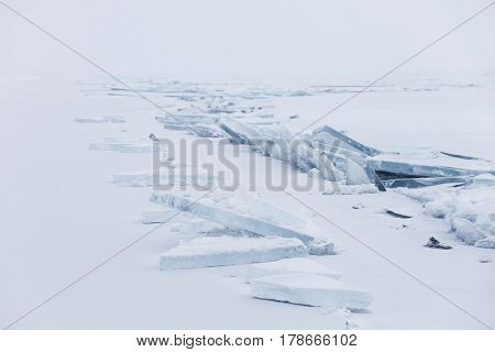 Turquoise Ice Floe. Winter Baikal Lake Landscape. Ice-drift