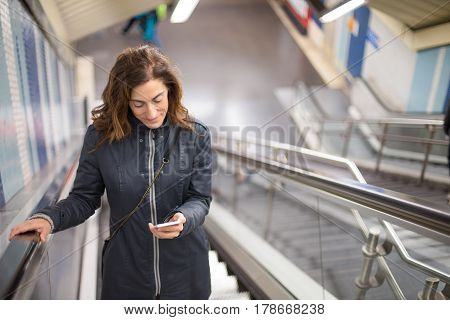 Woman In Subway Mechanic Stairs Reading Phone