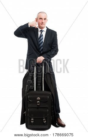 Business Man Standing With Carry On Luggage Showing Calling Gesture