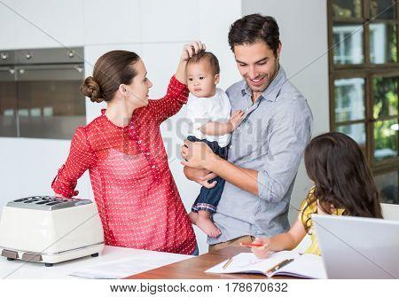 Happy family at desk in home