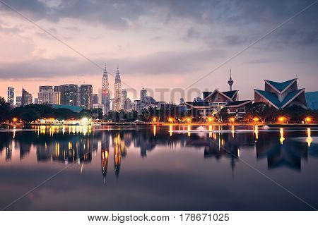 Kuala Lumpur at the sunrise and reflection of the city skyline in the lake Malaysia