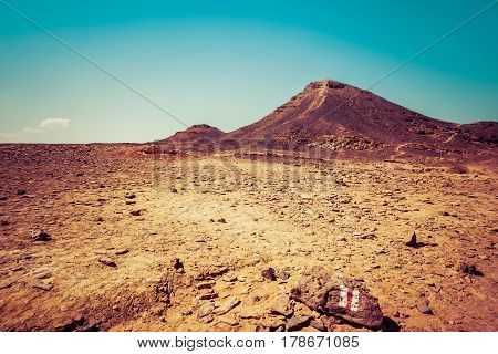 Desert Landscape With Two Hills And Yellow Dry Land. Makhtesh Ramon, Negev Desert, Israel.