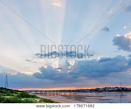 Beautiful Rays Of Light Protruding From Clouds Above Phillip Island Bridge At Sunrise. Melbourne, Vi