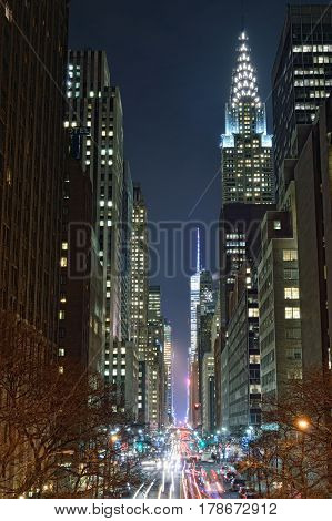 New York City, USA - December 11, 2015: NYC streets at night. Midtown Manhattan - 42nd Street with Chrysler Building.