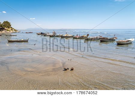 Coastal View With Boats