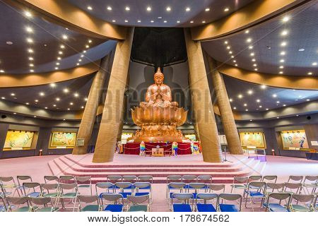 OKINAWA, JAPAN - MARCH 24, 2017: The giant Buddha inside Okinawa Peace Memorial Hall. The Memorial Hall is part of Peace Memorial Park which is dedicated to the Battle of Okinawa during World War Two.