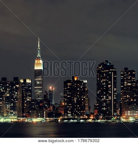 NEW YORK CITY, NY - JUL 11: Empire State Building at night on July 11, 2014 in New York City. It is a 102-story landmark and was world's tallest building for more than 40 years.