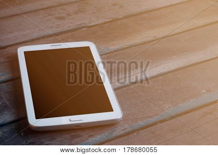 Tablets on the old wooden floor at home.