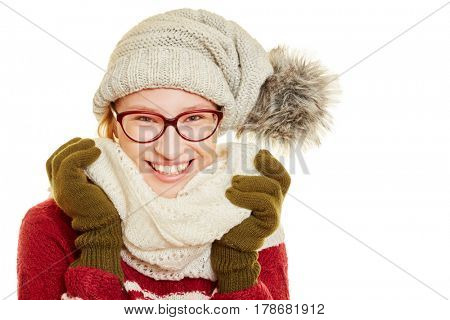 Blond smiling woman with glasses and winter clothing in winter