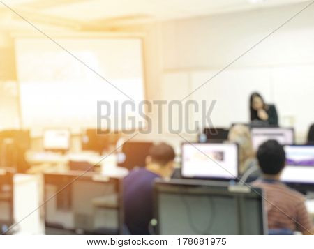 Education Concept On Blurred Students In Computer Room With Teachers. Classroom Learning With Techno