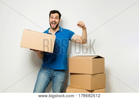 Young Man With A Cardboard Box In His Arms