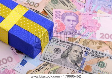 banknotes clear image of dollars and new bills Ukrainian national currency hryvnia with gift box