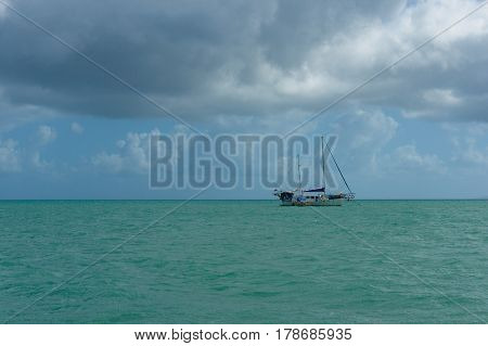 Yacht With Bare Poles On Calm Sunny Day