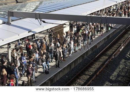 utrecht netherlands 15 march 2017: many travellers on platform of new central railway station in utrecht
