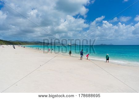 Whitsundays Australia - February 5 2017: Whitehaven beach with people having fun on famous silica white sand and turquoise blue waters. Queensland Australia