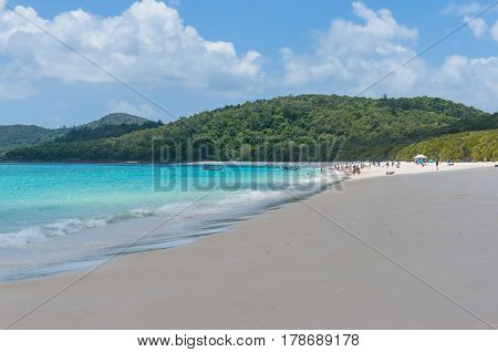 Tropical Island Beach With People In The Distance. Summer Background