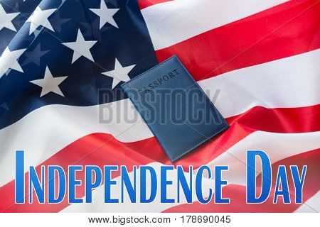 patriotism and national holidays concept - independence day words over american flag and passport