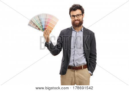 Bearded young man holding a color swatch isolated on white background