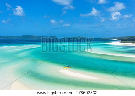 Bright Yellow Boat On Tropical Island Beach