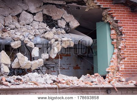 Hole In The Brick Wall Of Wrecked Building At Demolition Site