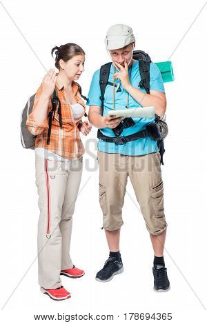 Couple Of Tourists Arguing And Looking For A Path On A Map On A White Background In The Studio