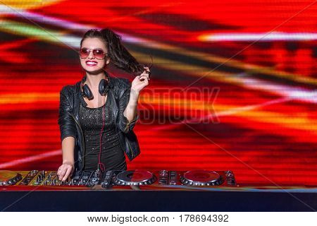 Smiling girl with mixing control