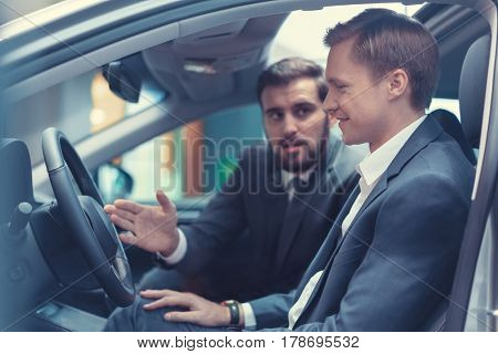 Young business people in car