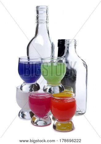 Cocktail in a glass and bottles on white background