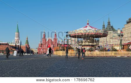 MOSCOW, RUSSIA - FEBRUARY 6, 2017: GUM-Fair in Red Square in Moscow in the background State Historical Museum
