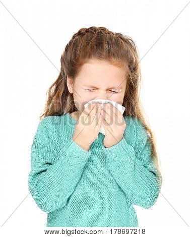 Ill little girl with tissue on white background