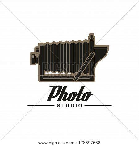 Photo studio symbol with retro folding camera. Unfolded vintage camera isolated icon with header Photo Studio below. Photographer emblem design