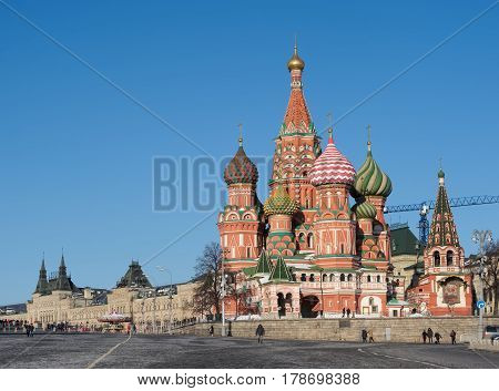 MOSCOW, RUSSIA - FEBRUARY 6, 2017: Red Square a view of St. Basil's Cathedral from Vasilevsky Descent