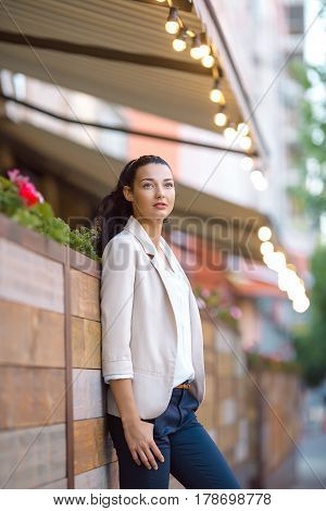 Confident woman - portrait of serious beautiful mixed race Asian Caucasian young businesswoman in casual clothes outdoor posing on city street looking away