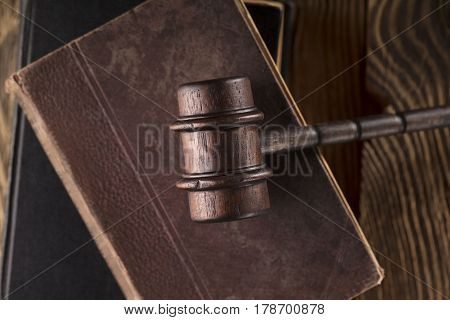Law theme, gavel of judge and legal code on wooden table. Top view. Place for typography and logo.