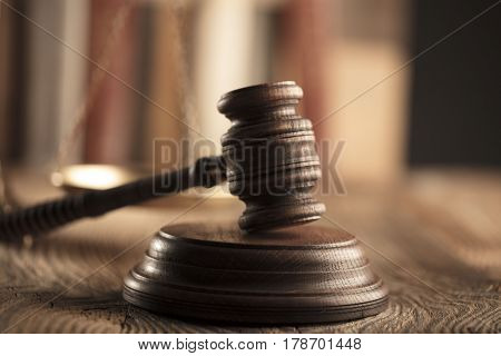 Law theme, gavel and legal code on wooden table