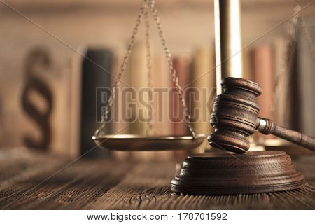 Law and justice concept - gavel and scale and legal code on wooden table