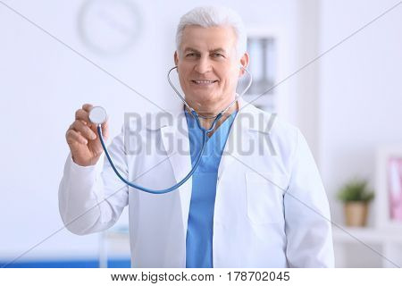 Doctor with stethoscope on blurred background