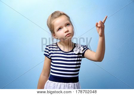 Cute little girl on color background
