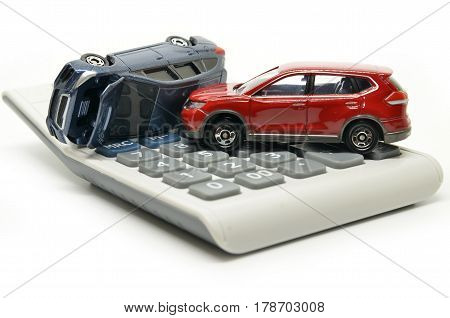 Car insurance concept with calculator on white background