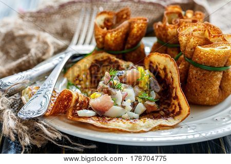 Crepes Stuffed With Herring, Egg And Green Onions.