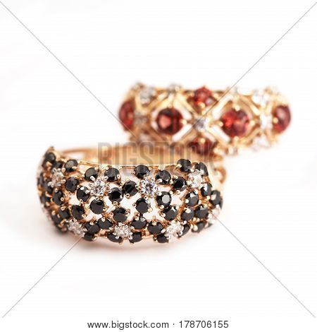 Elegant jewelry rings with jewel gem stone garnet and diamonds