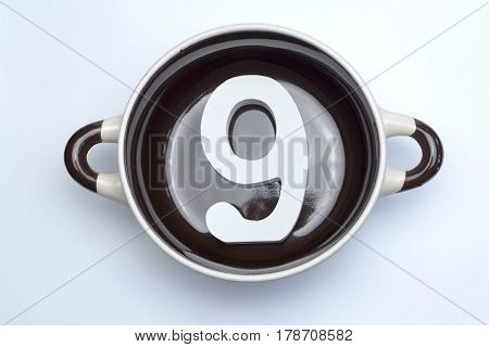 Number nine on the bottom of the soup tureen on white background.
