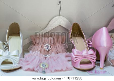 Beautiful wedding garters and shoes close up