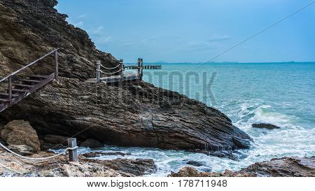 Wooden walkway for little adventure along the coastline to peninsula at Khao Laem Ya National Park Rayong Thailand