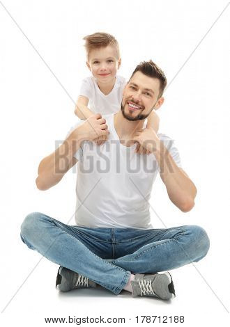 Handsome man and his son on white background