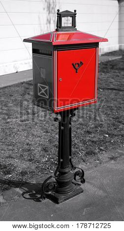 A typical red letter-box in Budapest on black and white background