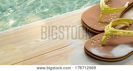 Summer beach vacation concept, flip flops on wood deck with clear transparent sea water on background