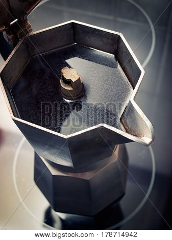 Top view of an Italian moca coffe maker full of fresh coffee.